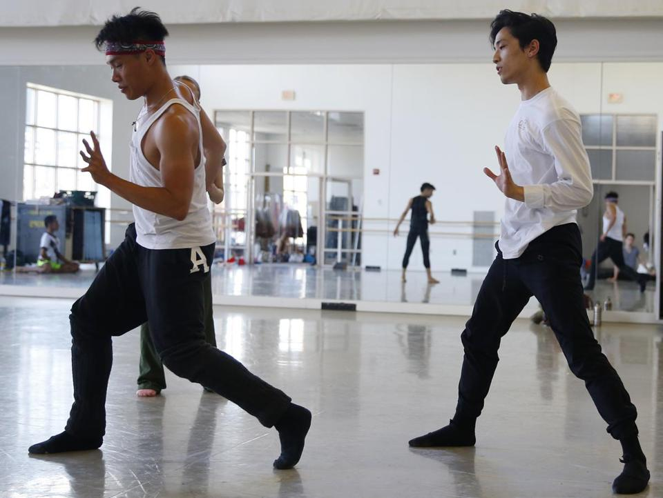 "Jeffrey Cirio (right) rehearsing the cast for the Boston Ballet's ""fremd."""